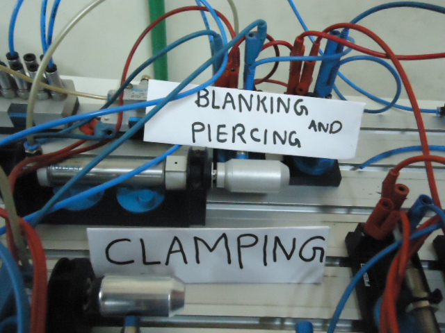 Automatic strip feeding for piercing and blanking using PLC